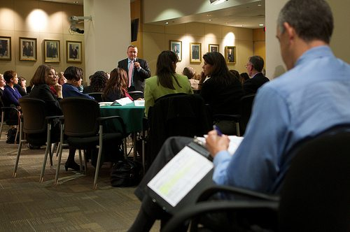 Secretary Duncan listens to educators and staff following a day of shadowing school principals.